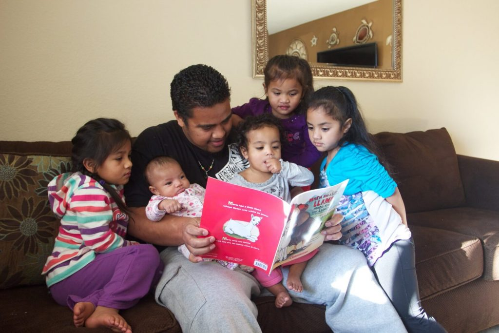 Parent reads to group of children