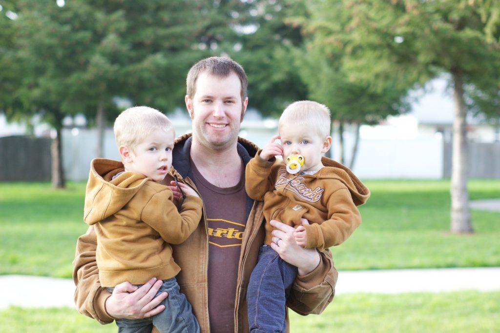 Parent holding children outdoors