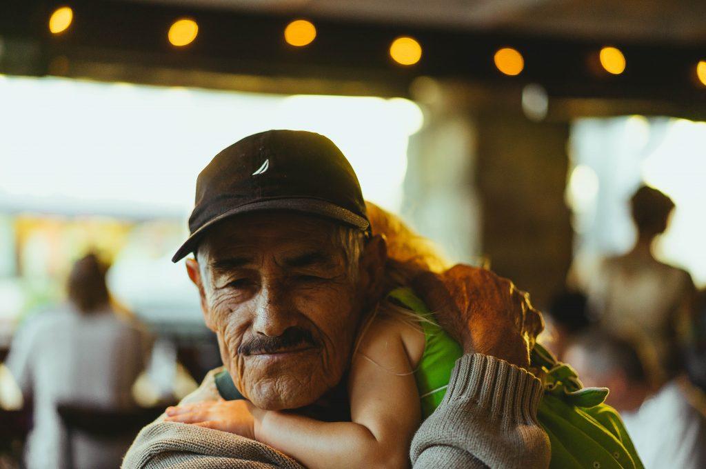 Grandparent holding child