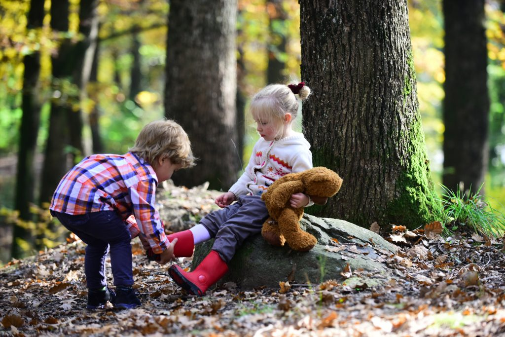 Portrait of two little children in the woods