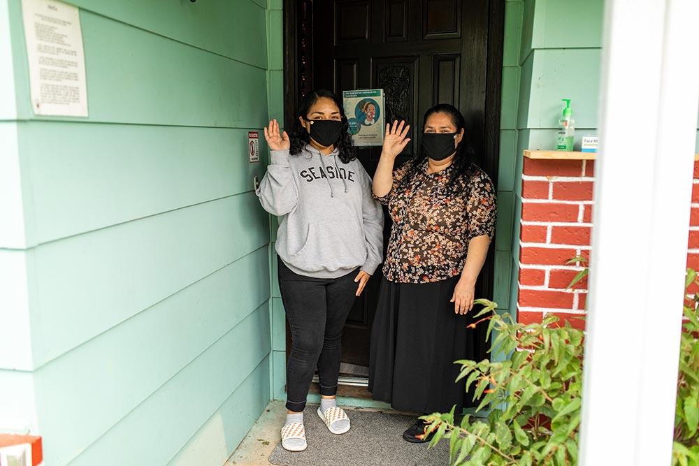 Analuisa Ayala Woodburn staff waving in masks.