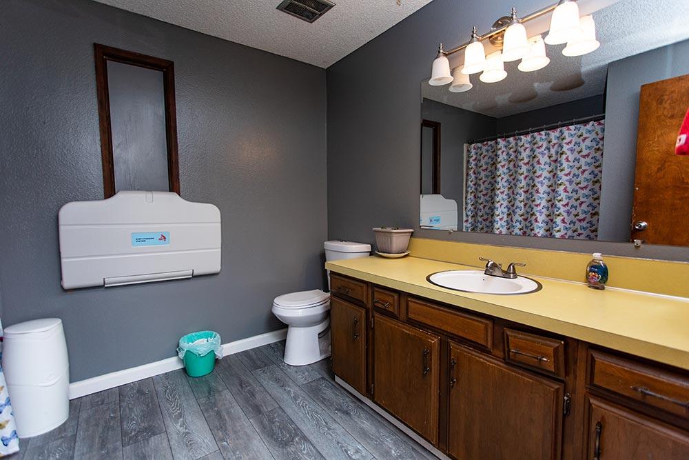 Analuisa Ayala Woodburn bathroom with changing table