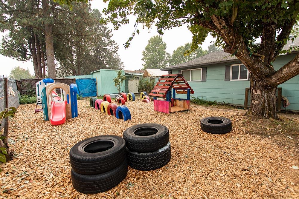 Analuisa Ayala Woodburn playground with tires