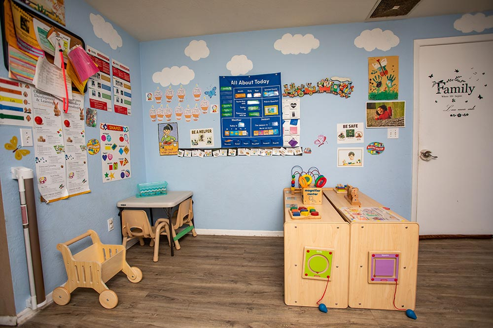 Busy Beez Daycare classroom with posters and play area