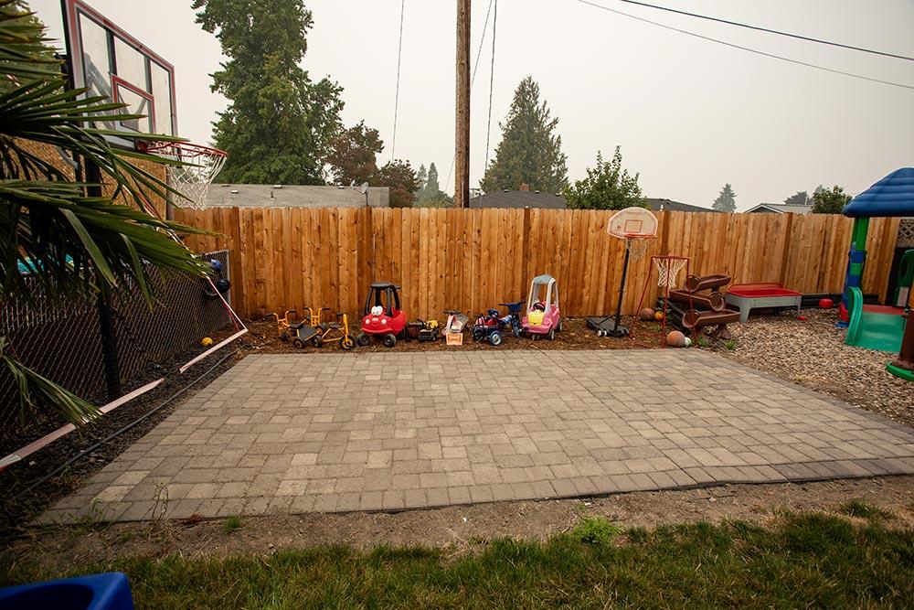 Busy Beez Daycare backyard patio with toys