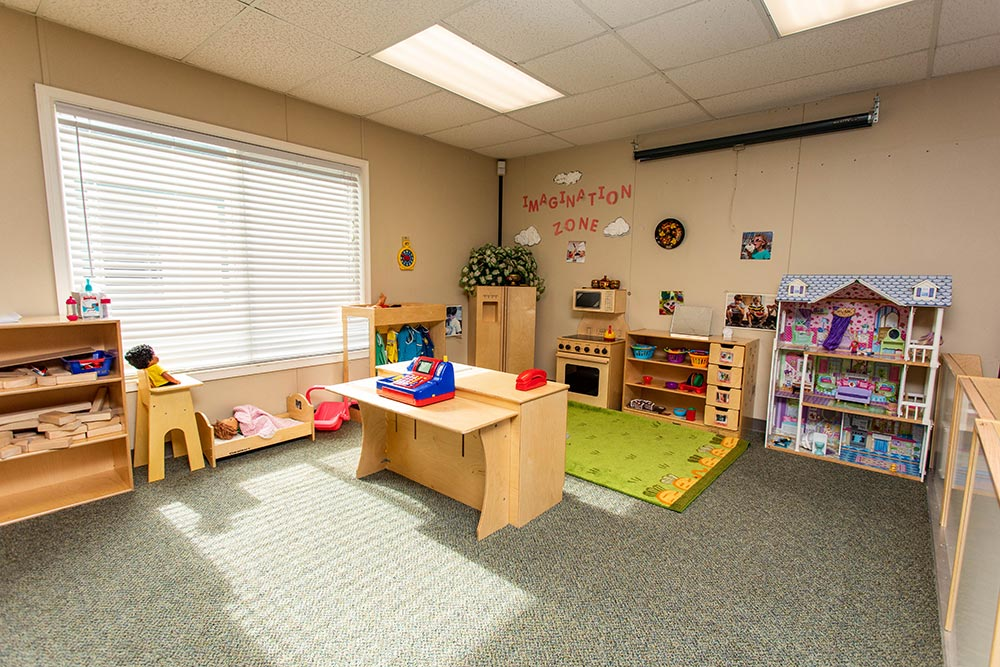Gervais School Play area with rug and projector screen