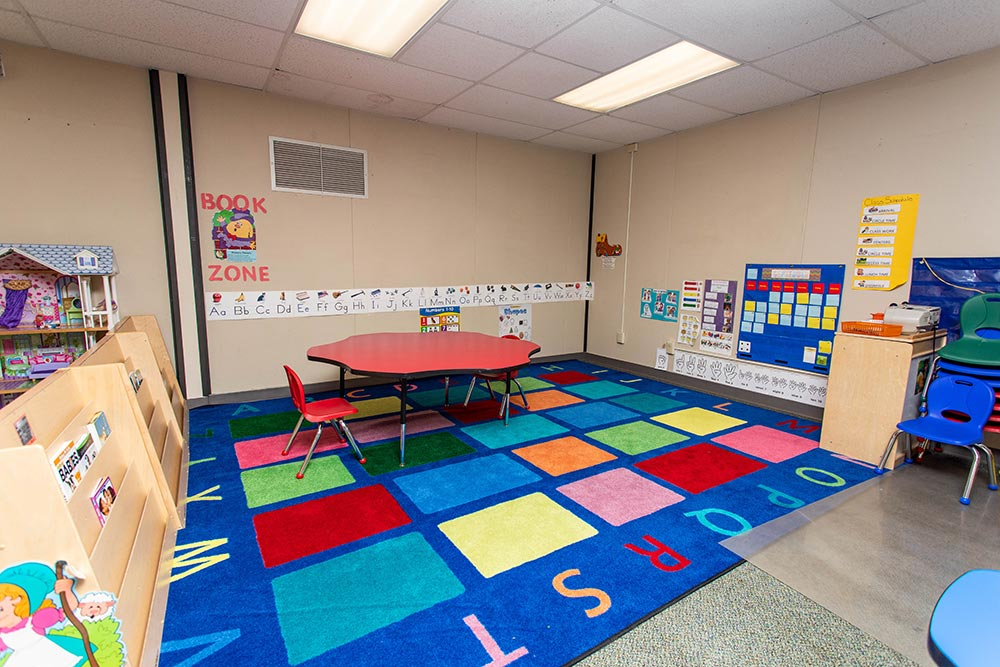 Gervais School classroom with bookshelves and ABC chart