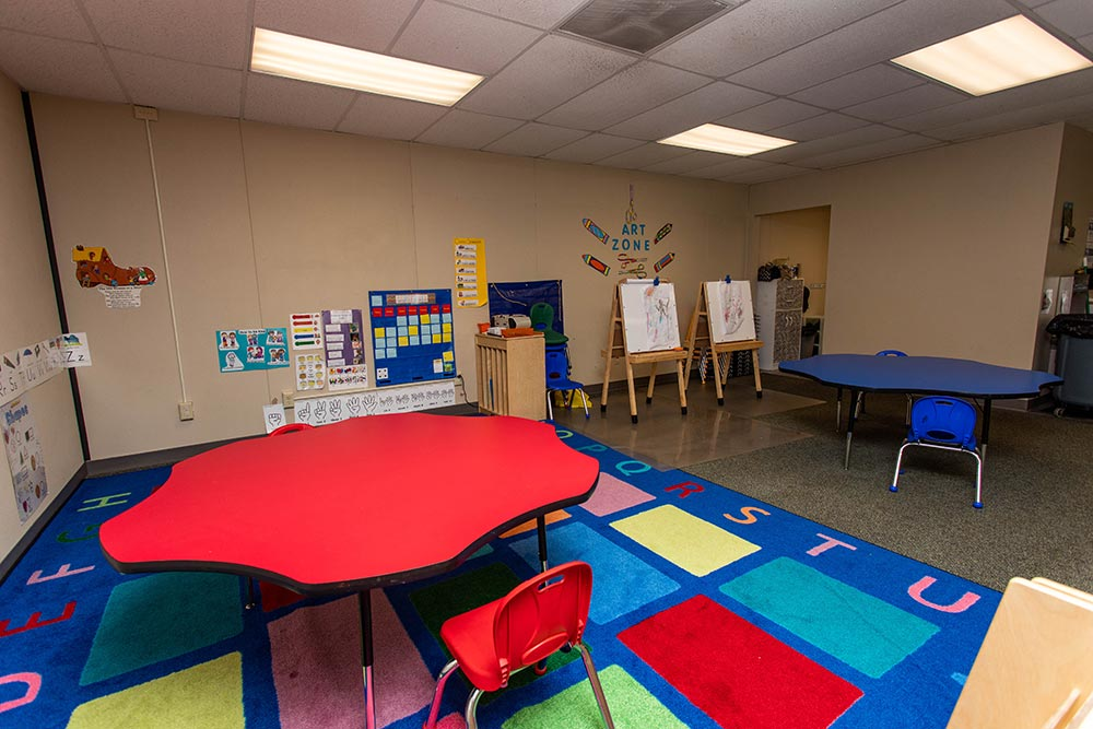 Gervais School classroom with tables and ABC rug