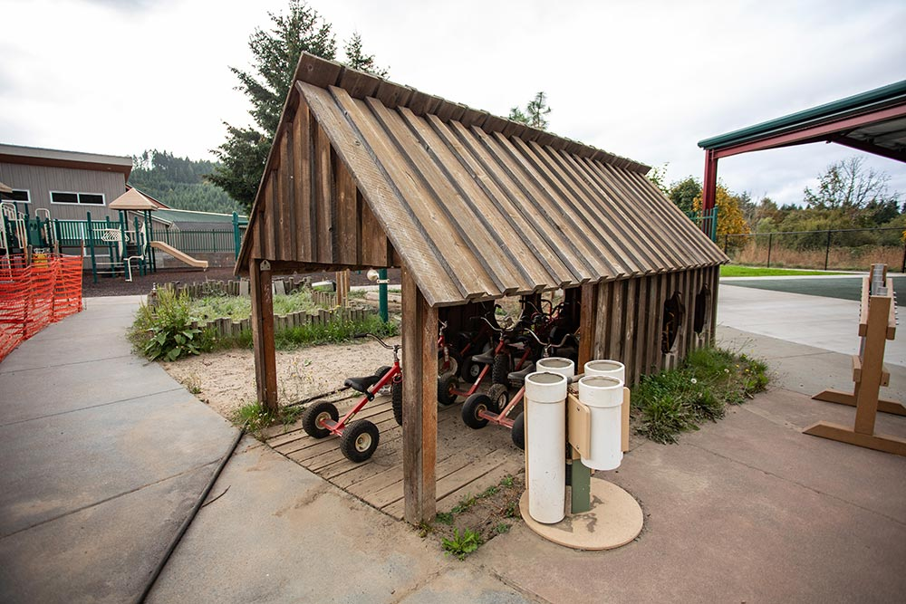 The Confederated Tribes of Grand Ronde outdoor tricycle parking hut