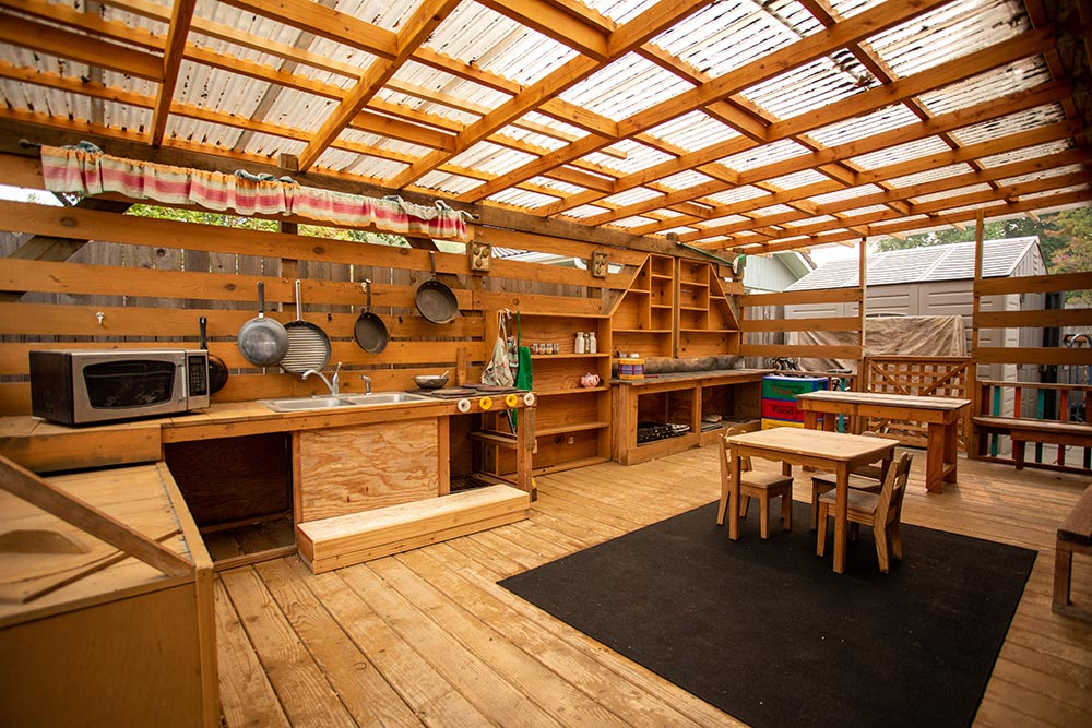Island Adventures Childcare and Preschool outdoor learning area and camp kitchen