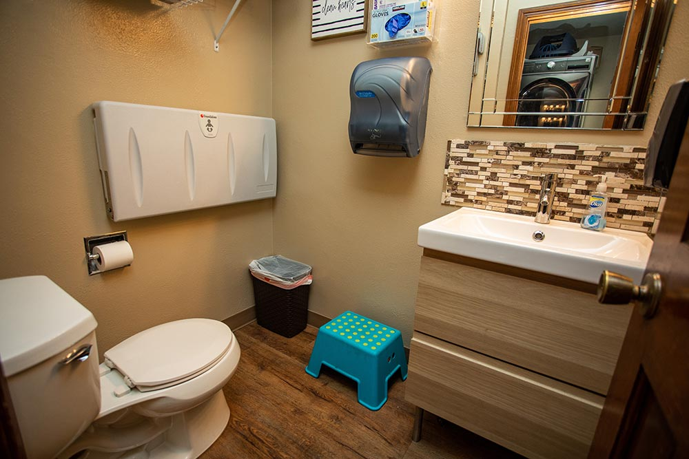 Island Adventures Childcare and Preschool bathroom with changing table