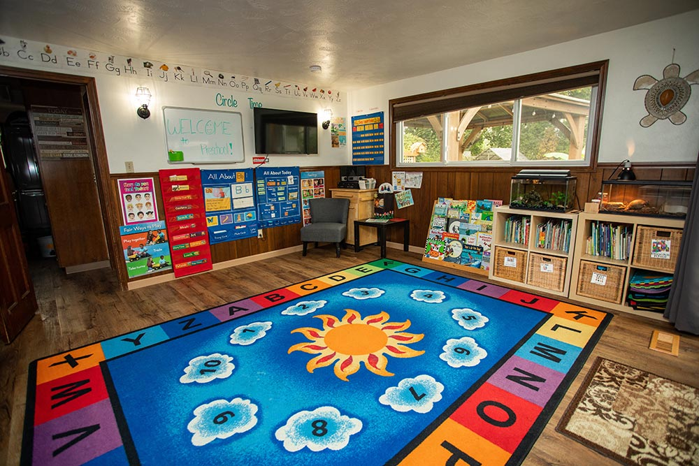 Island Adventures Childcare and Preschool ABC rug and cubbies