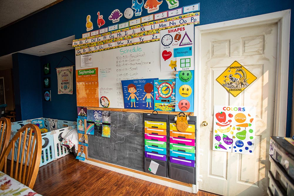 Laugh N Learn Academy Daycare whiteboard with learning posters