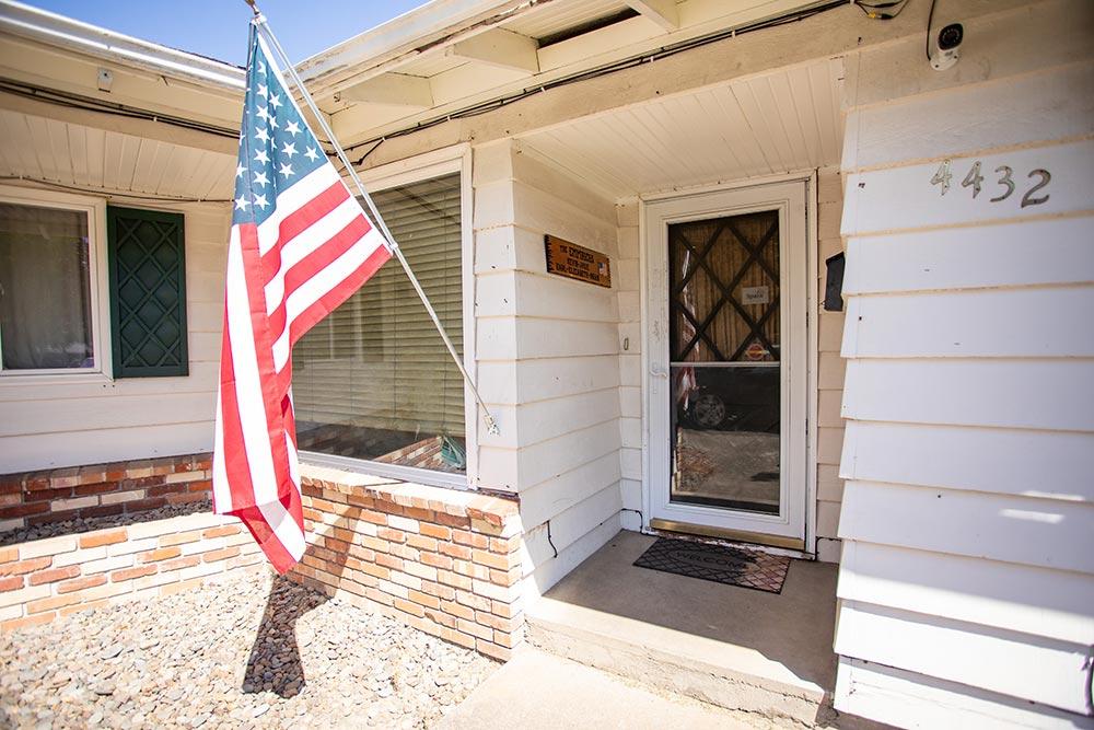 Loving Beginnings Childcare & Preschool front door with American flag