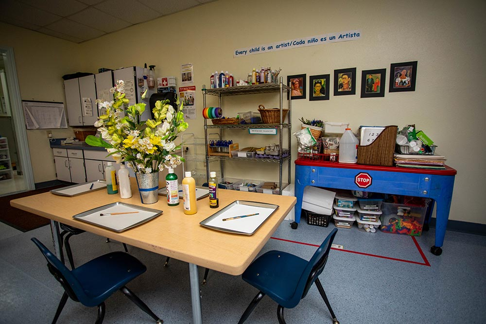 Oregon Child Development Coalition craft room with tables and art