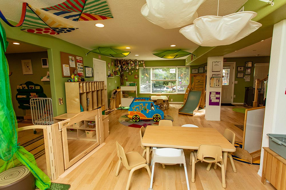Precious Cargo Preschool classroom decorated in big leaves and kites